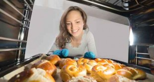 Woman Removing Bun View From Inside The Oven